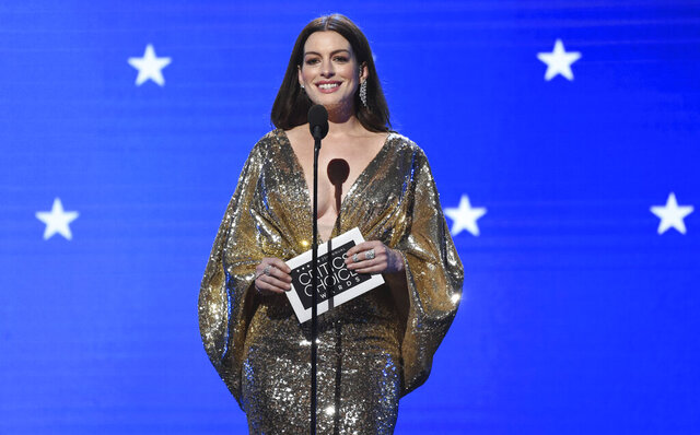 FILE - Anne Hathaway presents the award for best actor at the 25th annual Critics' Choice Awards on Sunday, Jan. 12, 2020, at the Barker Hangar in Santa Monica, Calif. Hathaway is among this year's inductees into the New Jersey Hall of Fame announced Wednesday, Aug. 5, 2020. (AP Photo/Chris Pizzello, File)
