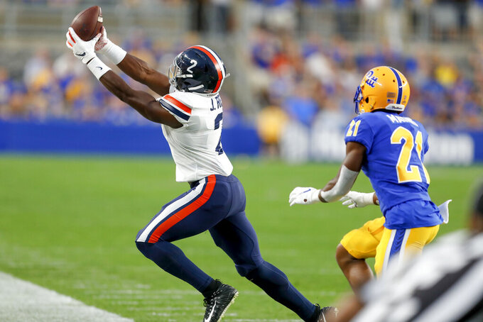 Virginia wide receiver Joe Reed (2) makes a catch along the sideline in front of Pittsburgh defensive back Damarri Mathis (21) in the first quarter of an NCAA college football game, Saturday, Aug. 31, 2019, in Pittsburgh. The call was reviewed and confirmed a catch. (AP Photo/Keith Srakocic)