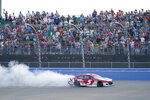 Kyle Larson (5) does a does a burnout after winning a NASCAR Cup Series auto race at Nashville Superspeedway Sunday, June 20, 2021, in Lebanon, Tenn. (AP Photo/Mark Humphrey)