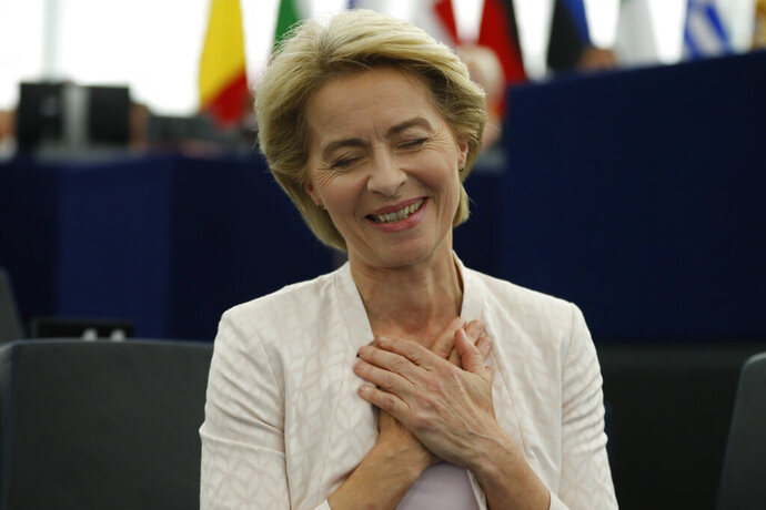 Ursula von der Leyen gestures after being elected as the new European Commission President at the European Parliament in Strasbourg, eastern France, Tuesday, July 16, 2019. (AP Photo/Jean-Francois Badias)