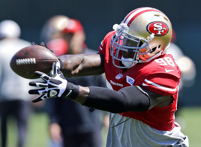 FILE - In this Aug. 12, 2013, file photo, San Francisco 49ers linebacker Parys Haralson reaches for the ball during NFL football training camp in Santa Clara, Calif. On Monday, Sept. 13, 2021, the San Francisco 49ers announced that Haralson, a former linebacker for the 49ers and New Orleans Saints, had died. He was 37. (AP Photo/Marcio Jose Sanchez, File)
