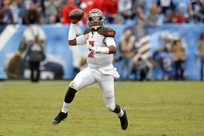 Tampa Bay Buccaneers quarterback Jameis Winston scrambles against the Tennessee Titans in the second half of an NFL football game Sunday, Oct. 27, 2019, in Nashville, Tenn. (AP Photo/Mark Zaleski)