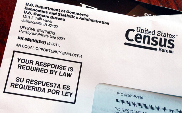 FILE - This March 23, 2018, file photo shows an envelope containing a 2018 census letter mailed to a U.S. resident as part of the nation's only test run of the 2020 Census. Most Americans say they are likely to participate in the 2020 census, but some doubt that the U.S. Census Bureau will keep their personal information confidential. A new poll from The Associated Press-NORC Center for Public Affairs Research finds 7 in 10 Americans say it's extremely or very likely they will participate in the census this year. (AP Photo/Michelle R. Smith, File)