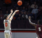 Virginia Tech's Hunter Cattoor (0) shoots a three-point basket over the defense of Maryland-Eastern Shore's Da'Shawn Phillip (5) in the first half of an NCAA college basketball game in Blacksburg, Va., Sunday, Dec. 29 2019. (Matt Gentry/The Roanoke Times via AP)