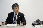 In this May 31, 2018, photo, Mitsubishi Electric Corp. Senior General Manager Yasuhide Shibata, who oversees the mapping project, speaks on some of the devices for making the 3D digital maps at the company's headquarters in Tokyo. Technology companies are racing to develop ultra-precise three-dimensional digital maps that can guide self-driving cars to within inches of where they are supposed to be - a hurdle the industry needs to clear if it hopes to deliver on its promise of widespread use of driverless vehicles. (AP Photo/Yuri Kageyama)