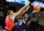 Villanova guard Phil Booth, right, shoots against DePaul guard Devin Gage during the first half of an NCAA college basketball game Wednesday, Jan. 30, 2019, in Chicago. (AP Photo/Nam Y. Huh)