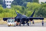 Hidden under tarpaulin, a prospective Russian fighter jet is seen being towed to a parking spot before its presentation at the Moscow international air show in Zhukovsky outside Moscow, Russia, Thursday, July 15, 2021. Russian aircraft makers say they will present a prospective new fighter jet at a Moscow air show that opens next week. The new warplane hidden under tarpaulin was photographed being towed to a parking spot across the airfield in Zhukovsky outside Moscow. That's where MAKS-2021 International Aviation and Space Salon opens on Tuesday. Russian President Vladimir Putin is set to visit the show's opening. (AP Photo/Ivan Novikov-Dvinsky)