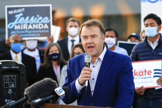 FILE—In this file photo from Oct. 6, 2020, David Pepper, the chairman of the Ohio Democratic Party, speaks at the Hamilton County Board of Elections as people arrive to participate in early voting in Norwood, Ohio. Pepper announced Monday, Nov. 30, 2020 that he is stepping down at the end of the year. (AP Photo/Aaron Doster, File)