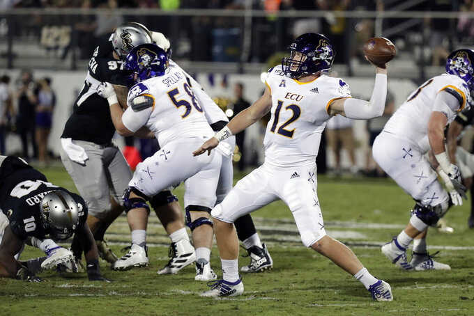 East Carolina quarterback Holton Ahlers (12) throws a pass while pressured by the Central Florida defense during the first half of an NCAA college football game, Saturday, Oct. 19, 2019, in Orlando, Fla. (AP Photo/John Raoux)