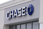 A Chase Bank is seen, Wednesday, Feb. 3, 2021, in Woburn, Mass.  The nation's largest banks are expected to report big profits for the first quarter, Tuesday, April 13,  amid renewed confidence that pandemic-battered consumers and businesses can repay their debts and start borrowing again. (AP Photo/Elise Amendola)