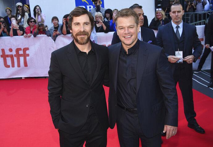 Christian Bale, left, and Matt Damon attend a premiere for