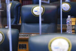 """The desk of Rep. Ron Hanks, R-Penrose, sits empty during second day of the 73rd General Assembly of the Colorado State Legislature, Thursday, Jan. 14, 2021, in Denver. Democrats in Colorado have condemned the Republican lawmaker for joking about lynching before saying a 18th century policy designating a slave as three-fifths of a person """"was not impugning anybody's humanity."""" (Hyoung Chang/The Denver Post via AP)"""