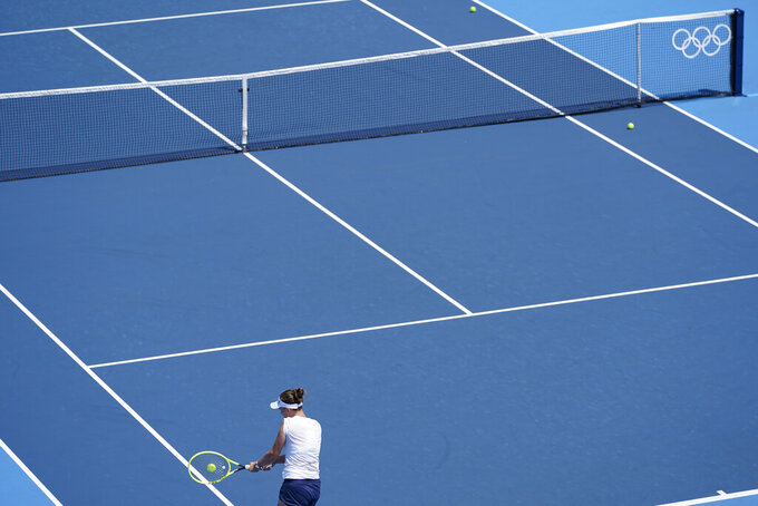 Czech Republic's Barbora Krejcikova practices for the women's tennis competition ahead of the 2020 Summer Olympics, Friday, July 23, 2021, in Tokyo, Japan. (AP Photo/Patrick Semansky)