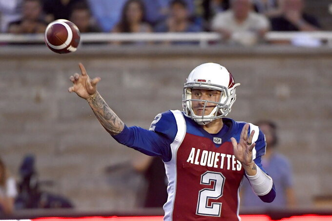 FILE - In this Aug. 3, 2018, file photo, Montreal Alouettes quarterback Johnny Manziel (2) throws a pass during the first half of a Canadian Football League game against the Hamilton Tiger-Cats in Montreal. Manziel has been signed by the Alliance of American Football and will join the Memphis Express.  The quarterback's rights belonged to San Antonio of the spring league, but that team declined to sign him and Manziel then was free to join any of the other seven clubs. (Paul Chiasson/The Canadian Press via AP, File)