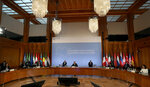 German Foreign Minister Heiko Maas, center, delivers a welcome speech at the beginning of the 'Second Berlin Conference on Libya' at the foreign office in Berlin, Germany, Wednesday, June 23, 2021. (AP Photo/Michael Sohn, pool)