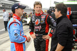 FILE - In this May 21, 2010, file photo, car owner Michael Andretti, right, talks with his son Marco Andretti, center, and cousin John Andretti during practice for the Indianapolis 500 auto race at the Indianapolis Motor Speedway in Indianapolis. John Andretti, a member of one of racing's most families, has died following a battle with colon cancer, Andretti Autosports announced Wednesday, Jan. 30, 2020. He was 56.  (AP Photo/Tom Strickland, File)