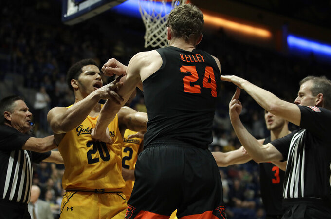 Oregon State's Kylor Kelley (24) shoves California's Matt Bradley, left, in the second half of an NCAA college basketball game Saturday, Feb. 1, 2020, in Berkeley, Calif. Both were called with technical fouls. (AP Photo/Ben Margot)