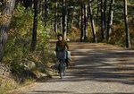 In this Oct. 23, 2018, photo, a woman rides her bicycle through the Mount Kumgang resort area in North Korea. A decade after the North-South experiment in tourism cooperation in Kumgang ended in bitter failure following the fatal shooting of a South Korean tourist in 2008, North Korean leader Kim Jong Un and South Korean President Moon Jae-in want to give it another try amid opposition from Washington. (AP Photo/Dita Alangkara)