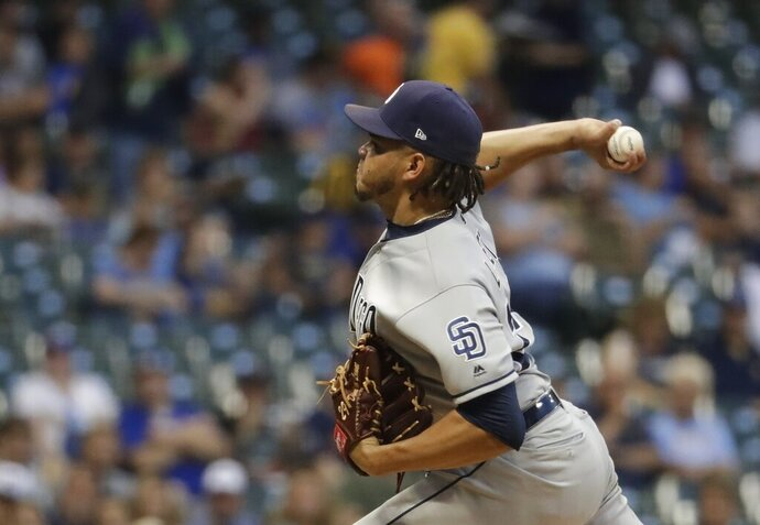 San Diego Padres starting pitcher Dinelson Lamet throws during the first inning of a baseball game against the Milwaukee Brewers Wednesday, Sept. 18, 2019, in Milwaukee. (AP Photo/Morry Gash)
