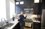 In this April 13, 2019, photo, Parry Harrison, 26, speaks during an interview in his townhouse in the Daybreak development, in South Jordan, Utah.  Harrison bought a townhouse in Daybreak for $309,000 in March, using proceeds from the sale of a house that appreciated a robust 25% in the two years he owned it. (AP Photo/Rick Bowmer)