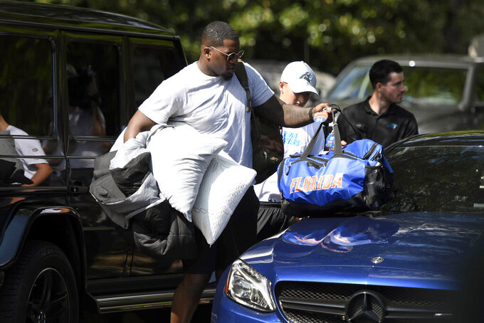 FILE - In a Wednesday, July 25, 2018 file photo, Carolina Panthers defensive end Bryan Cox Jr. arrives for NFL football training camp at Wofford College in Spartanburg, S.C.The Bills have signed defensive end Bryan Cox Jr., whose father never hid his dislike for Buffalo during his days playing for the AFC rival Miami Dolphins in the 1990s. Cox Jr. was signed to a one-year contract Wednesday, April 29, 2020 after splitting last season between Carolina and Cleveland. (David T. Foster III/The Charlotte Observer via AP, File)