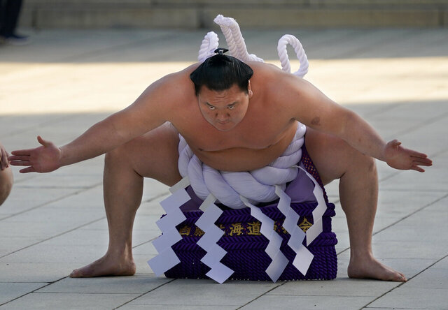 \In this Jan. 9, 2018, file, photo, Sumo grand champion Hakuho of Mongolia performs his ring entry form at the Meiji Shrine in Tokyo. (AP Photo/Shizuo Kambayashi,File)