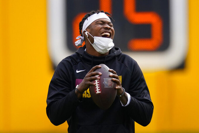 Washington Football Team quarterback Dwayne Haskins (7) laughing during pregame warms-ups on the field before the start of an NFL football game against the Cincinnati Bengals and Washington Football Team, Sunday, Nov. 22, 2020, in Landover. (AP Photo/Al Drago)