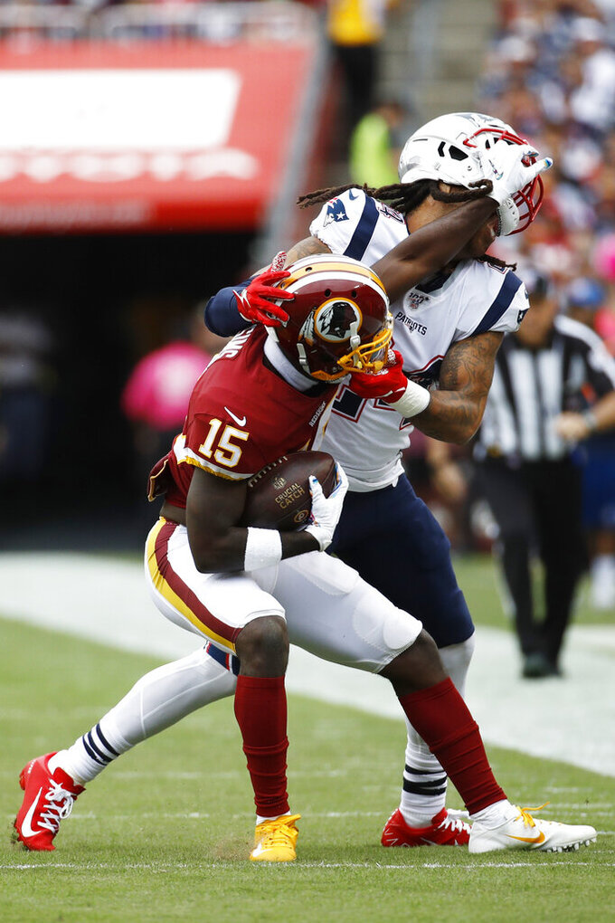 Washington Redskins wide receiver Steven Sims (15) runs into New England Patriots cornerback Stephon Gilmore (24) during the first half of an NFL football game, Sunday, Oct. 6, 2019, in Washington. (AP Photo/Patrick Semansky)