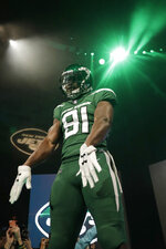 "New York Jets wide receiver Quincy Enunwa models the NFL football team's new ""Gotham green"" uniform Thursday, April 4, 2019, in New York. (AP Photo/Julio Cortez)"