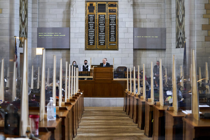 Nebraska Gov. Pete Ricketts addresses lawmakers in Lincoln, Neb., Thursday, Aug. 13, 2020, on the last day of a legislative session marked by major disruptions from the coronavirus and political feuds that often turned personal. (AP Photo/Nati Harnik)