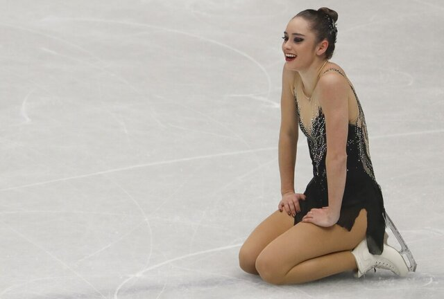 FILE- In this March 23, 2018, file photo, Kaetlyn Osmond, of Canada, reacts after completing her women's free skating program at the Figure Skating World Championships in Assago, near Milan, Italy. For the better part of two decades, Osmond knew exactly what she'd be doing every day. Her world revolved around figure skating. She retired last May and hasn't competed since winning gold at the 2018 world championships. And while she's at peace with her decision, the months since haven't been all that smooth. (AP Photo/Luca Bruno, File)