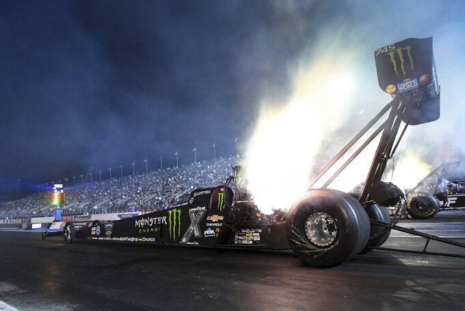 In this photo provided by the NHRA, Brittany Force drives in Top Fuel qualifying Friday night, Sept. 3, 2021, for the NHRA U.S. Nationals drag races at Lucas Oil Raceway in Brownsburg, Ind. (Marc Gewertz/NHRA via AP)