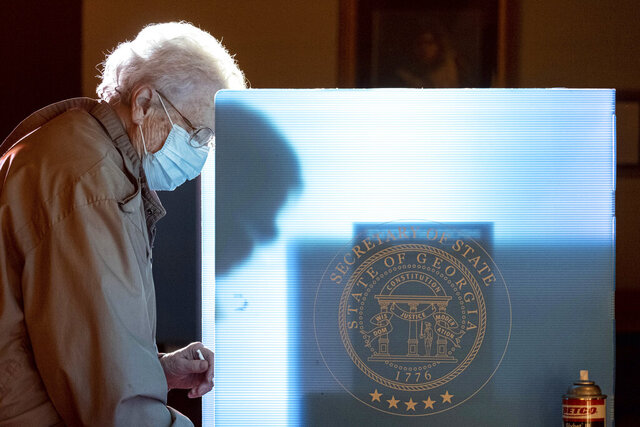 Helen Thomason marks her ballot at the Lawrenceville Road United Methodist Church in Tucker, Ga. during the Senate runoff election Tuesday morning, Jan. 5, 2021. (AP Photo/Ben Gray)