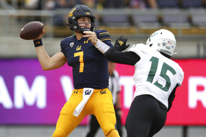 California quarterback Chase Garbers throws against Sacramento State defender Marte Mapu during the first half of an NCAA college football game on Saturday, Sept. 18, 2021, in Berkeley, Calif. (AP Photo/Jed Jacobsohn)