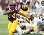 Minnesota running back Mohamed Ibrahim (24) runs against Purdue defensive back Brennan Thieneman (38) in the second quarter of an NCAA college football game Saturday, Nov. 10, 2018, in Minneapolis. (AP Photo/Andy Clayton-King)