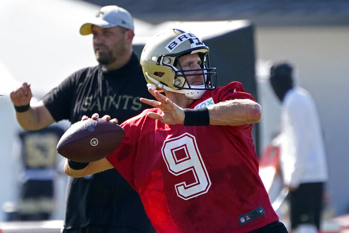 FILE - In this Aug. 22, 2020, file photo, New Orleans Saints quarterback Drew Brees (9) passes during practice at their NFL football training facility in Metairie, La. In the first matchup of 40-plus quarterbacks in NFL annals, during one of the most anticipated openers the league has seen _ though it won't be seen by fans at Raymond James Stadium due to the coronavirus pandemic _ Tom Brady makes his Buccaneers debut against that youngster Brees and the Saints. (AP Photo/Gerald Herbert, Pool, File)