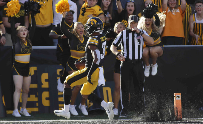 Iowa wide receiver Tyrone Tracy Jr. (3) runs to the end zone to score a touchdown during the second half of an NCAA college football game against Colorado State, Saturday, Sept. 25, 2021, in Iowa City, Iowa. (AP Photo/Ron Johnson)