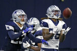 Dallas Cowboys wide receiver CeeDee Lamb, right, catches a pass in front of safety Darian Thompson, left, during an NFL football training camp in Frisco, Texas, Sunday, Aug. 23, 2020. (AP Photo/Michael Ainsworth)