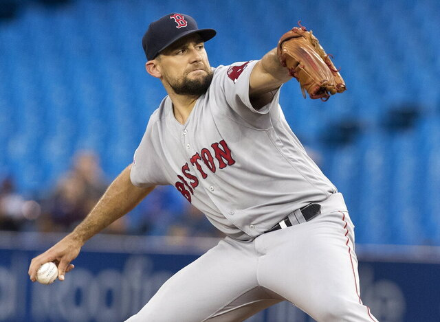 FILE - In this Sept. 10, 2019, file photo, Boston Red Sox starting pitcher Nathan Eovaldi throws to a Toronto Blue Jays batter during the first inning of a baseball game in Toronto. (Fred Thornhill/The Canadian Press via AP, File)