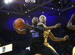 Buffalo guard Dontay Caruthers (22) lays up the ball past Kent State BJ Duling (2) during the first half of an NCAA college basketball game, Friday, Feb. 22, 2019, in Buffalo, N.Y. (AP Photo/Jeffrey T. Barnes)
