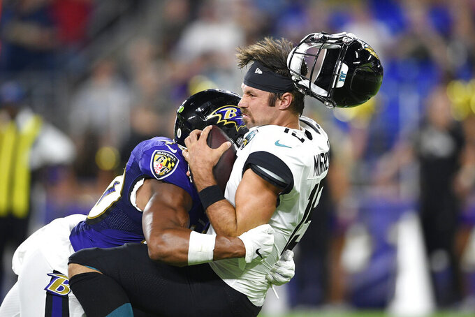 Baltimore Ravens inside linebacker Kenny Young, left, sacks Jacksonville Jaguars quarterback Gardner Minshew during the first half of an NFL football preseason game Thursday, Aug. 8, 2019, in Baltimore. (AP Photo/Nick Wass)