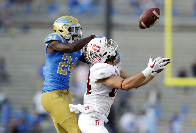 UCLA defensive back Jay Shaw (24) breaks up a pass intended for Stanford tight end Colby Parkinson during the second half of an NCAA college football game Saturday, Nov. 24, 2018, in Pasadena, Calif. (AP Photo/Marcio Jose Sanchez)
