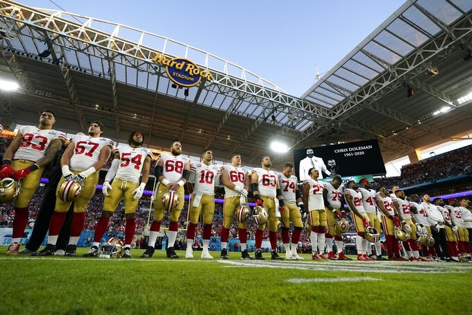 San Francisco 49ers players stand for a moment of remembrance before the NFL Super Bowl 54 football game against the Kansas City Chiefs Sunday, Feb. 2, 2020, in Miami Gardens, Fla. (AP Photo/David J. Phillip)