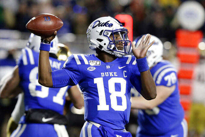 Duke quarterback Quentin Harris (18) passes against Notre Dame during the first half of an NCAA college football game in Durham, N.C., Saturday, Nov. 9, 2019. (AP Photo/Gerry Broome)