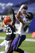 Baltimore Ravens tight end Mark Andrews (89) makes a catch over Cleveland Browns strong safety Andrew Sendejo (23), during the second half of an NFL football game, Sunday, Sept. 13, 2020, in Baltimore, MD. (AP Photo/Nick Wass)