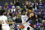 Stanford's Tyrell Terry, right, tries to get past Washington's Isaiah Stewart (33) and Marcus Tsohonis during the first half of an NCAA college basketball game Thursday, Feb. 20, 2020, in Seattle. (AP Photo/Elaine Thompson)