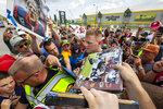 Houston Texans' J.J. Watt signs autographs after a joint NFL football practice with the Green Bay Packers Monday, Aug 5, 2019, in Green Bay, Wis. (AP Photo/Mike Roemer)