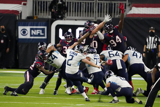 Tennessee Titans kicker Sam Sloman (2) kicks a 37-yard game-winning field goal against the Houston Texans during the second half of an NFL football game Sunday, Jan. 3, 2021, in Houston. The Titans won 41-38. (AP Photo/Eric Christian Smith)