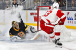 Detroit Red Wings' Darren Helm (43) scores past Boston Bruins' Tuukka Rask (40) during the first period of an NHL hockey game in Boston, Saturday, Feb. 15, 2020. (AP Photo/Michael Dwyer)