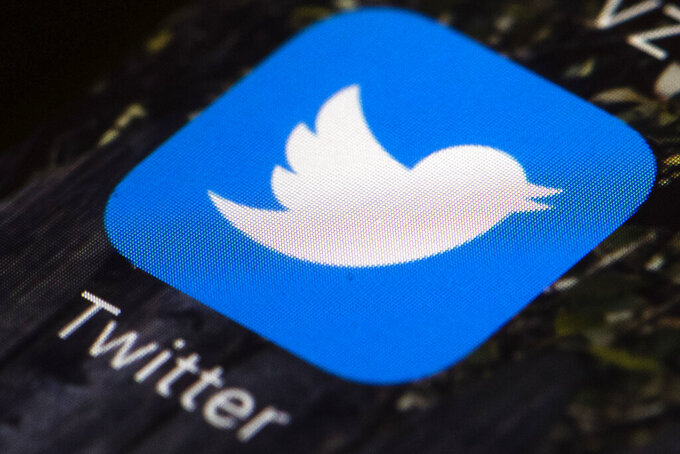 """FILE - This April 26, 2017, file photo shows the Twitter app icon on a mobile phone in Philadelphia. Twitter on Thursday, May 27, 2021 said it is worried about the safety of its staff in India and called for the government to respect freedom of expression, days after Indian police visited its office in New Delhi over its labeling of a tweet by a governing party spokesman as """"manipulated media."""" (AP Photo/Matt Rourke, File)"""